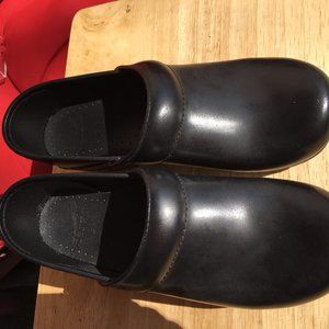 Dansko Black Leather Professional Stapled Clogs